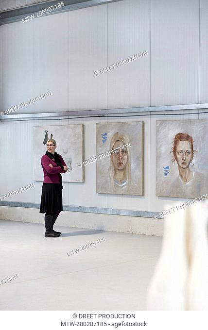Mature woman in an art gallery, Bavaria, Germany