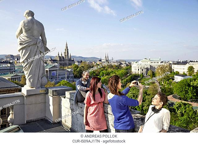 Group of young adult tourists taking pictures, Vienna, Austria