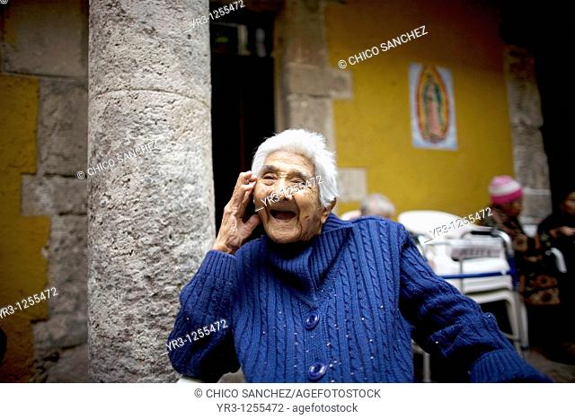Isabel Alarcon, 99, smiles in Our Lady of Guadalupe Home for the Elderly, Mexico City