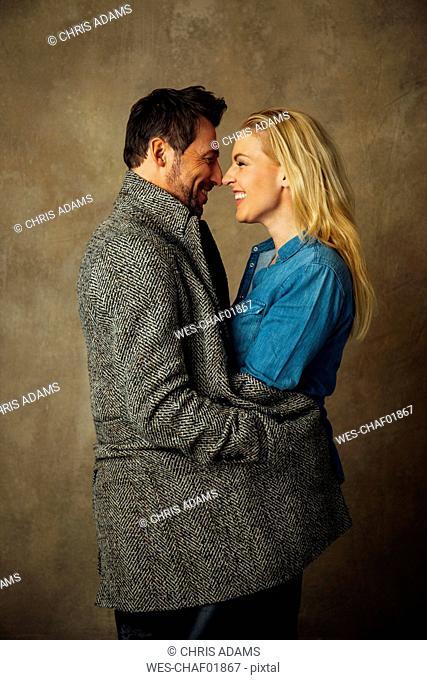 Happy couple rubbing nose