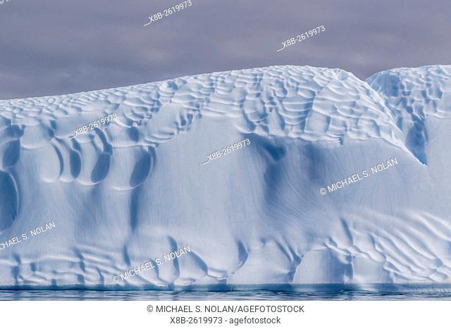 Sculpted iceberg at Booth Island, Antarctica