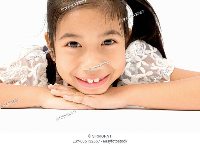 Portrait of asian cute girl with smile face and looking at camera, on gray background