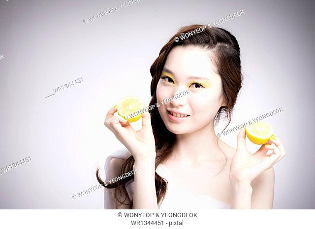 a woman with heavy yellow make up