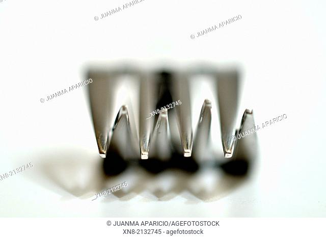 Conceptual image of forks over white background