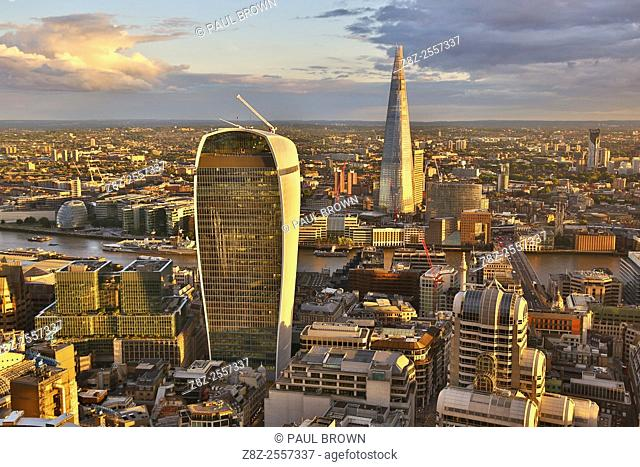 General view of buildings of the city skyline, the Walkie Talkie building at 20 Fenchurch Street and the Shard at dusk in London, England
