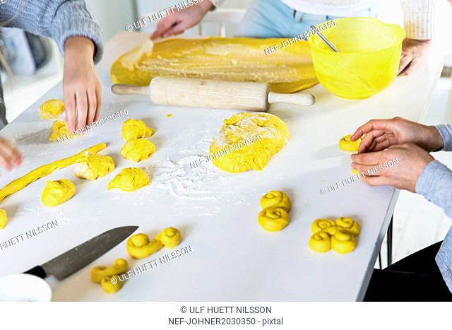 Children making saffron rolls