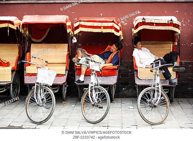 Cycle rickshaw drivers resting