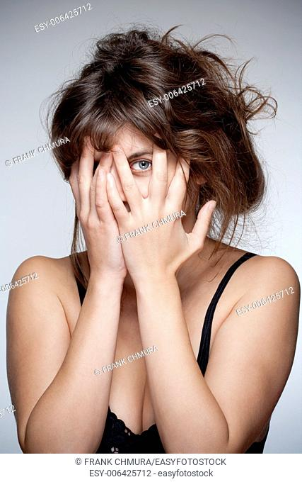 Woman Covering Face with Hand, Looking with One Eye through Fingers