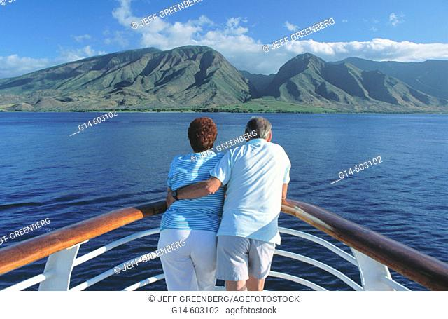 Senior couple on vacation on a cruise ship. Auau channel, near Maui