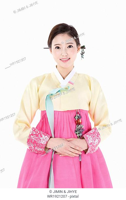 a woman dressed in a traditional Korean outfit