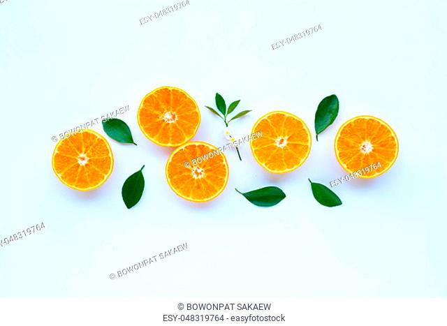 High vitamin C, Orange fruits with leaves on white background. Top view