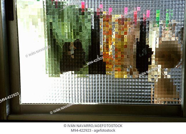 Clothesline as seen through translucent glass
