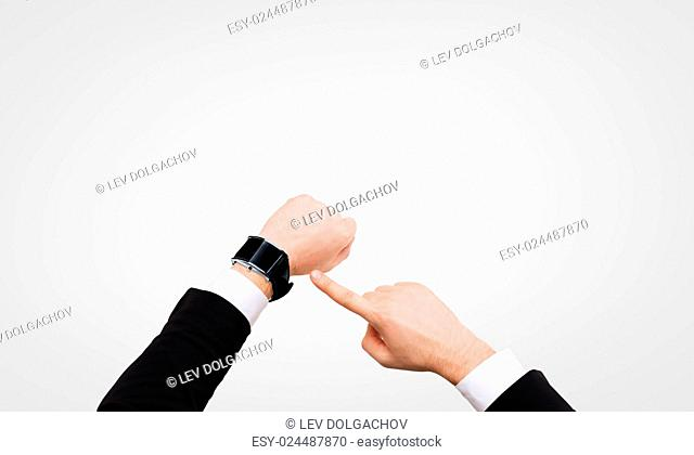time, business and new technology concept - close up of businessman pointing to smart watch at his hand