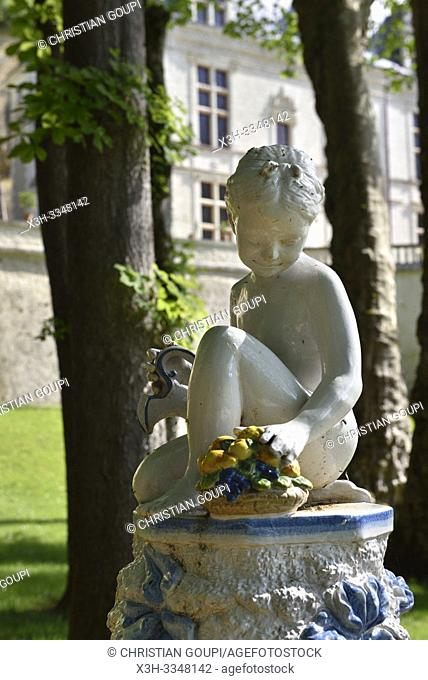 little girl statue with jug and basket of fruit in the gardens of the Royal Domain of Chateau-Gaillard at Amboise, Touraine, department of Indre-et-Loire