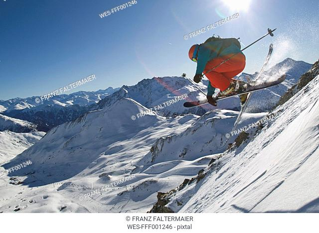 Austria, Tirol, Ischgl, Man ski jumping in snow