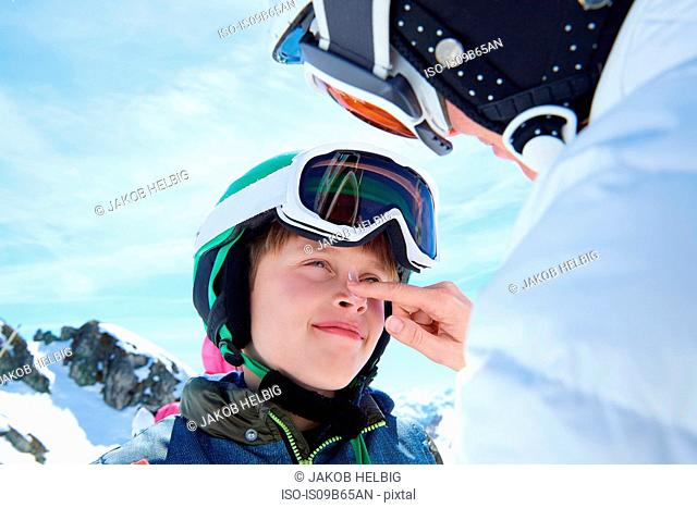 Mother putting sunscreen on son, Hintertux, Tirol, Austria