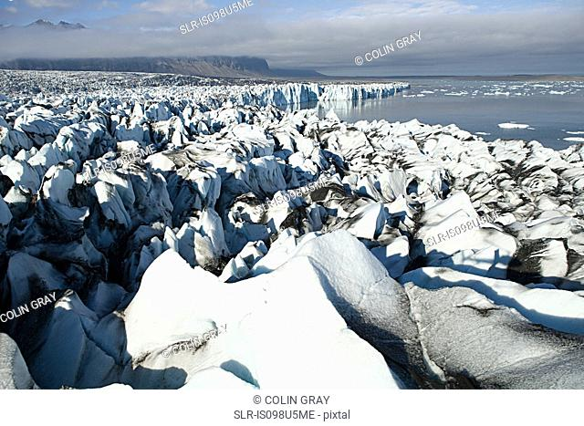 Iceland, icebergs in jokulsarlon lagoon drifting from vatnajokull glacier into the north atlantic ocean