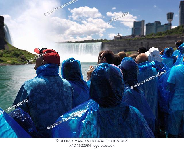 People in blue rain coats on Niagara Falls Maid of the Mist boat ride