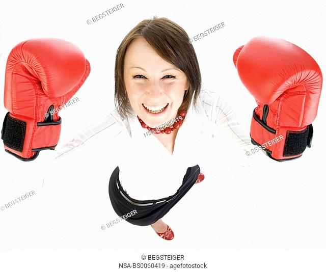 young business woman with boxing gloves
