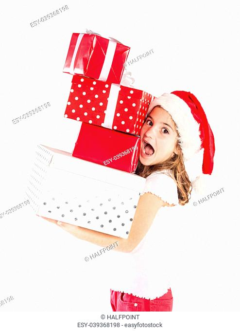 Happy small girl in santa hat with christmas gift