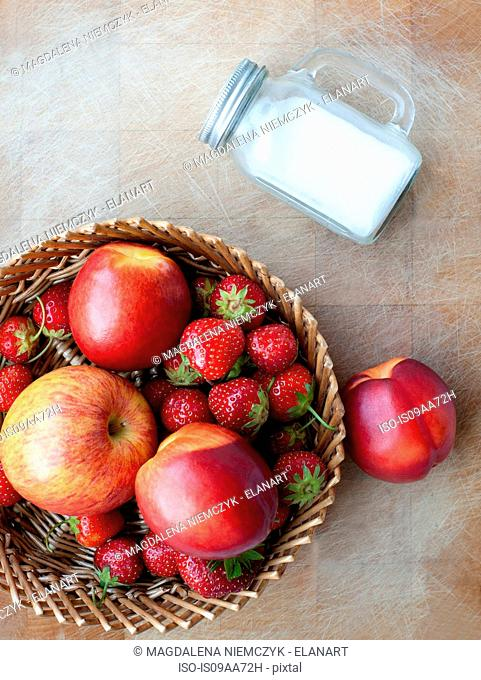Basket of apple, peaches and strawberries, overhead view