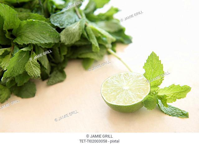 Mint and halved lemon on table