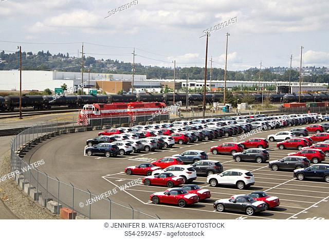 New vehicles and Tacoma Rail locomotives at the Port of Tacoma, Washington State, USA