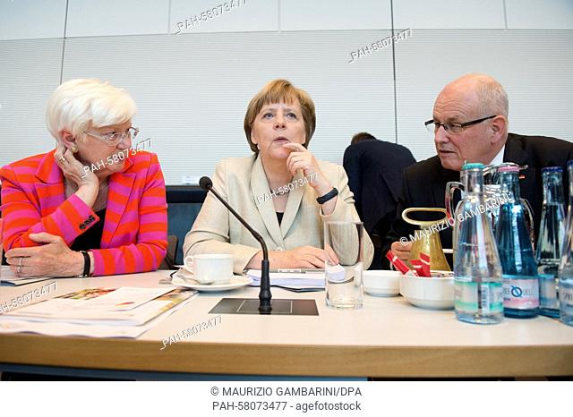 Chairwoman of the CSU regional faction Gerda Hasselfeldt (CSU, l-r), German Chancellor Angela Merkel (CDU) and parliamentary party leader Volker Kauder...