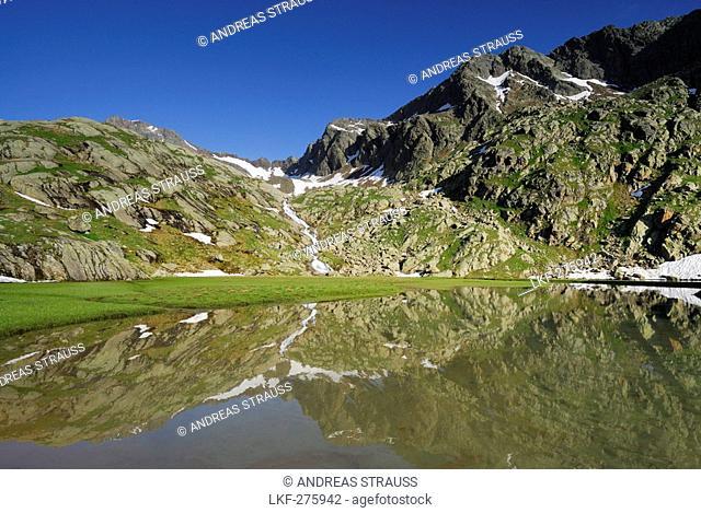 Reflection of mountains on lake Stubensee, Stubai Alps, Trentino-Alto Adige/South Tyrol, Italy