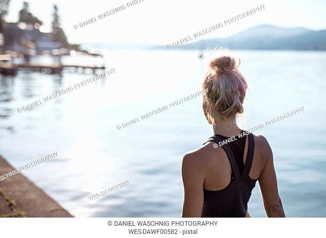 Rear view of woman in sportswear at a lake