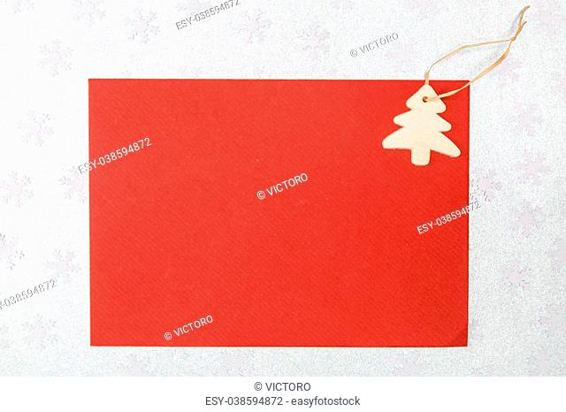 card with chritmas tree on silver snowflakes background