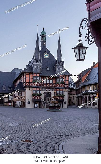 Germany, Wernigerode, view to town hall at market square in the evening