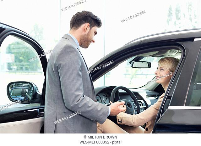 At the car dealer, Couple at new car