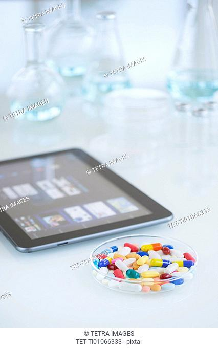 Studio shot of tablet pc and colorful pills