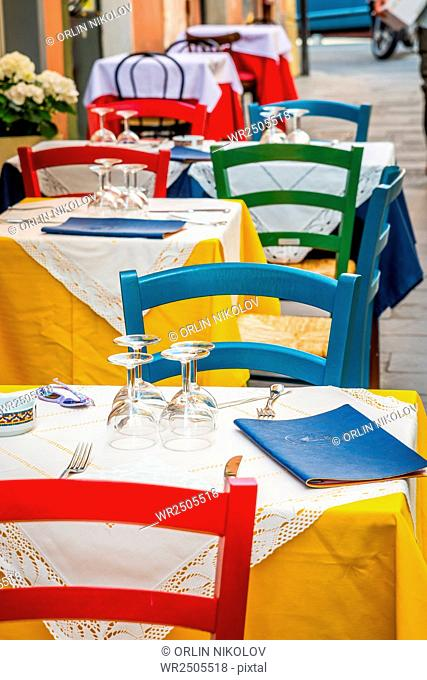 Tables and chairs of restaurant on the street
