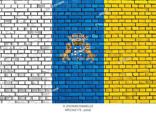 flag of Canary Islands painted on brick wall