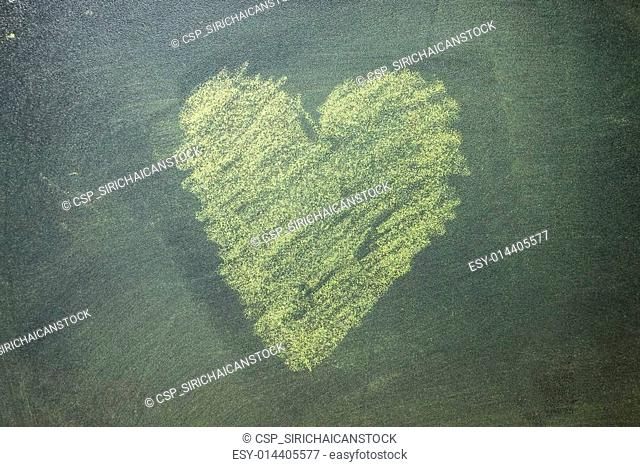 Hand drawn yellow hearts on chalkboard background