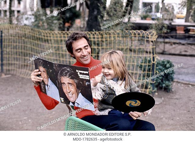 Italian actor and TV host Walter Chiari (Walter Annichiarico) showing to his son and Italian TV host Simone Annichiarico the record called In compagnia di...