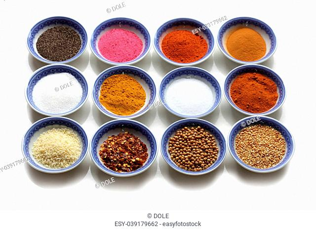 Oriental spices in the bows over white background