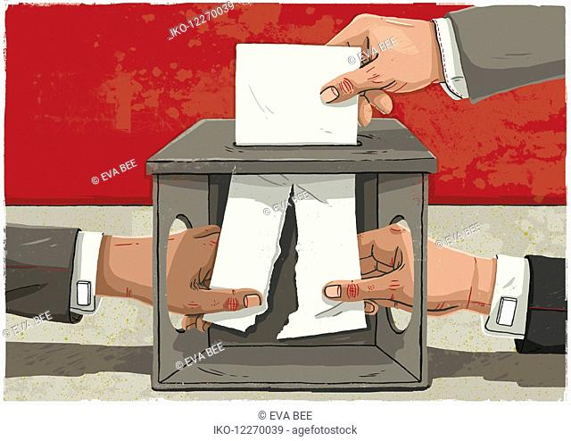 Hands tearing voting paper in half inside ballot box