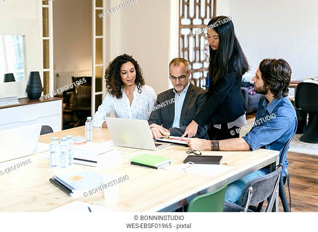Business people having a team meeting in office