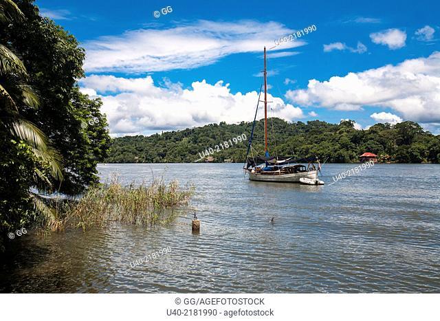 Guatemala, Rio Dulce, anchored sailboat