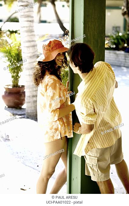 Young Hispanic couple talking