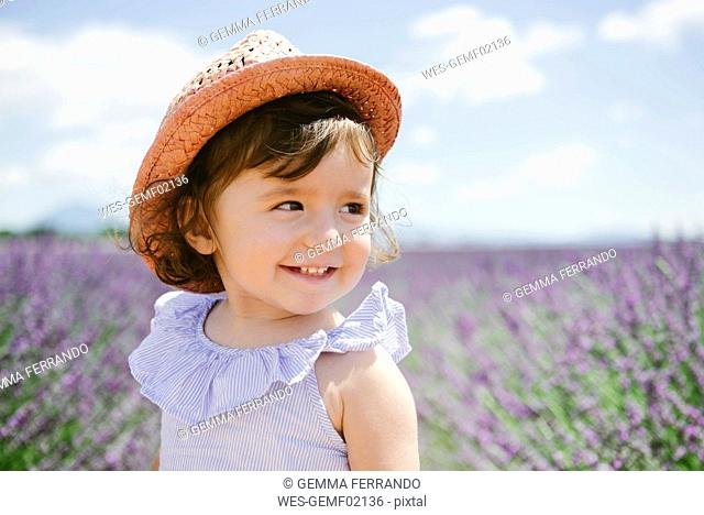 France, Provence, Valensole plateau, Happy toddler girl in purple lavender fields in the summer