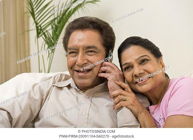 Couple sharing a mobile phone