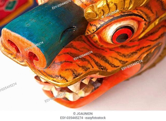 Sacred Buddhist tiger or lion woden colorful sculpture