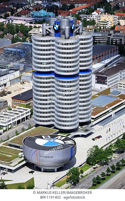The BMW four-cylinder, also BMW Tower, BMW skyscraper, in front the BMW Museum in Munich, Bavaria, Germany, Europe