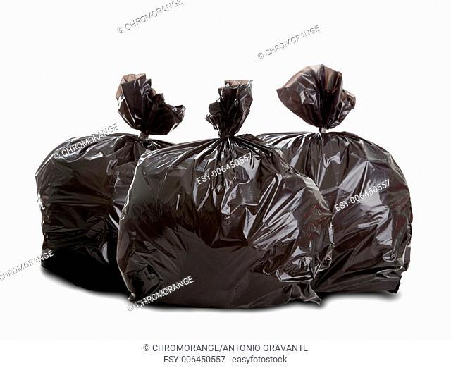 Three black rubbish bags on white background