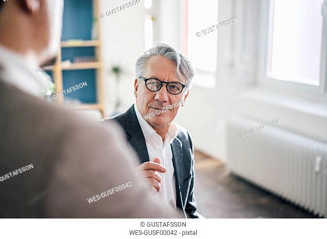 Senior businessman with partner in office