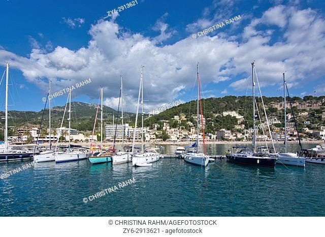 View over inlet bay, marina and boats on a sunny day in May in Port de Soller, Mallorca, Spain